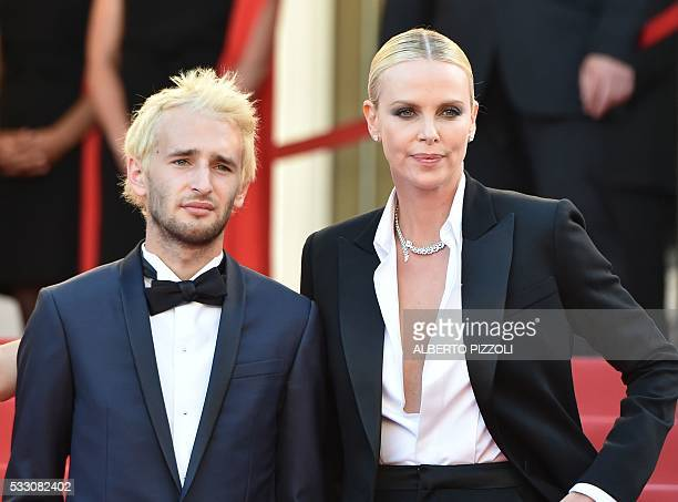 South AfricanUS actress Charlize Theron and US director Sean Penn's son Hopper Jack Pennposea s they arrive on May 20 2016 for the screening of the...