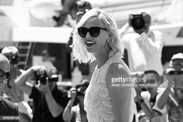 South AfricanUS actress Charlize Theron arrives on May 20 2016 to attend a photocall for the film 'The Last Face' at the 69th Cannes Film Festival in...