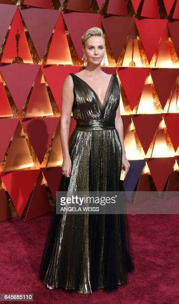 South AfricanUS actress Charlize Theron poses as she arrives on the red carpet for the 89th Oscars on February 26 2017 in Hollywood California / AFP...