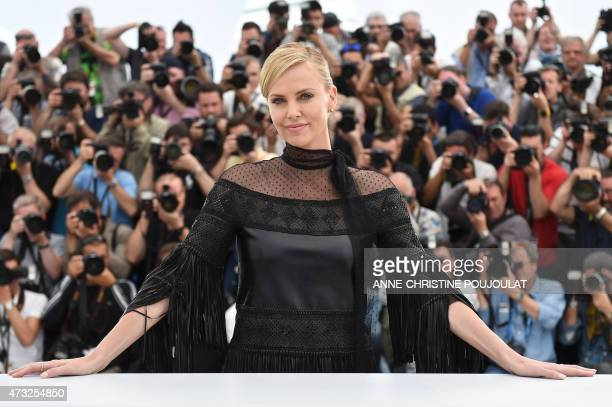 "South African-US actress Charlize Theron poses during a photocall for the film ""Mad Max : Fury Road"" during the 68th Cannes Film Festival in Cannes,..."