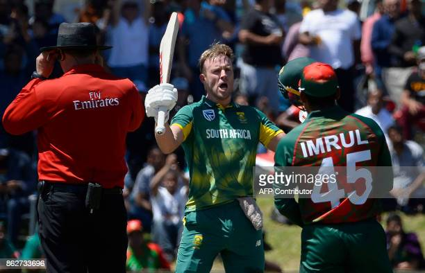 TOPSHOT South Africa's AB de Villiers celebrates after scoring a century during the second one day international cricket match between South Africa...