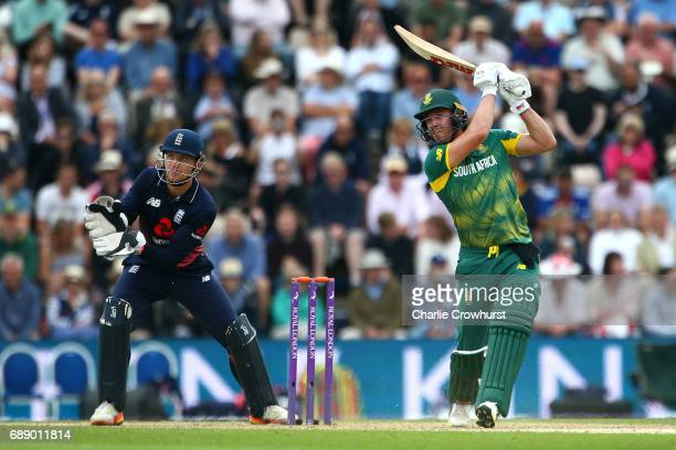 South Africa's AB de Villiers hits out while England wicket keeper Jos Butler looks on during the Royal London ODI match between England and South...