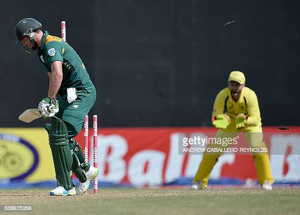 South Africa's AB de Villiers is bowled by Australia's Nathan CoulterNile during a Oneday International cricket match between South Africa and...