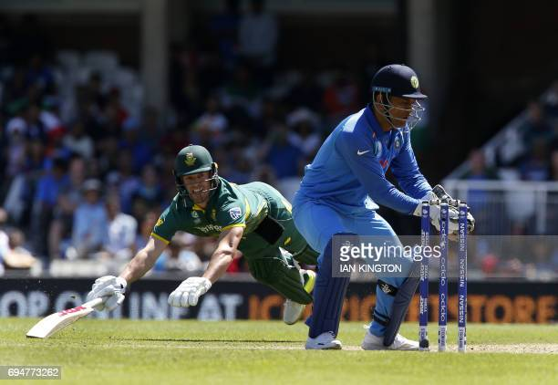South Africa's AB de Villiers is run out as India's MS Dhoni stumps the wicket during the ICC Champions Trophy match between South Africa and India...