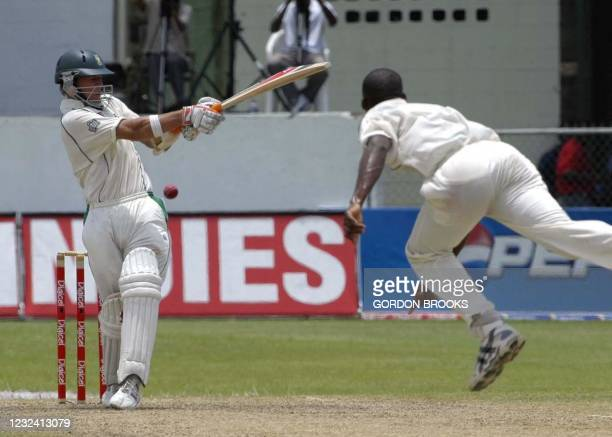 South Africa's AB DeViliers pulls West Indies' bowler Darren Powell on the second day of the 3rd Digicel Test 22 April 2005 at Kensington Oval,...