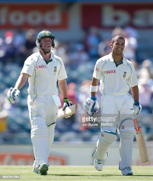South Africa's AB DeVilliers and JeanPaul Duminy celebrate victory against Australia at the WACA