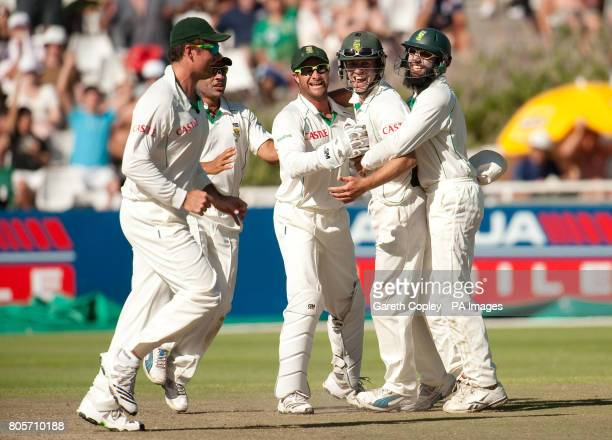South Africa's AB deVilliers celebrates with Mark Boucher and Hashim Alma after dismissing England's Matt Prior during the Third Test at Newlands...