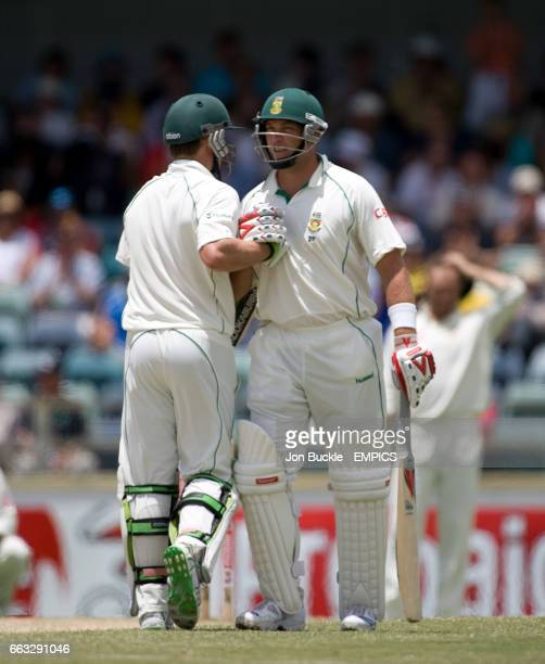 South Africa's AB DeVilliers congratulates Jacques Kallis on his half century on day five of the first test against Australia at the WACA