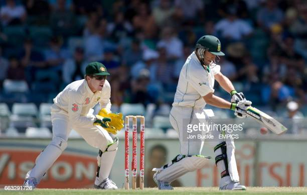 South Africa's AB DeVilliers in acion on day five of the first test against Australia as Brad Haddin watches on