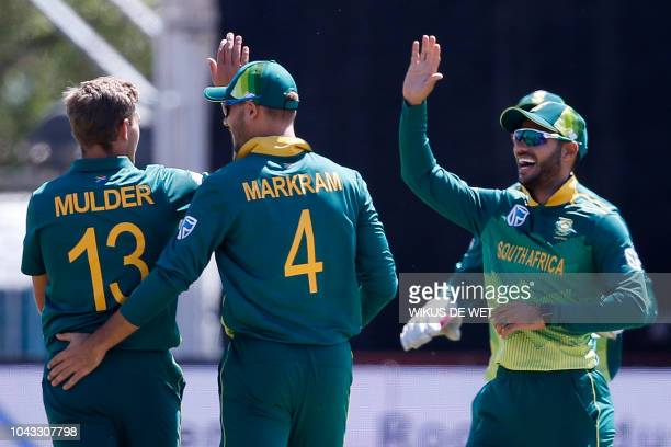 South Africa's Aiden Markram and teammate Willem Mulder celebrate after dismissing Zimbabwe's Craig Ervine during the first One Day International...