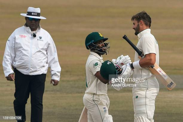 South Africa's Aiden Markram celebrates with teammate Temba Bavuma after scoring a century during the fifth and final day of the second Test cricket...