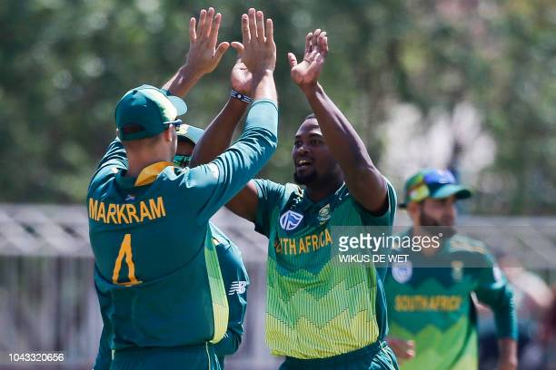 South Africa's Aiden Markram congratulates his teammate Andile Phehlukwayo after he dismissed Zimbabwe's Sean Williams by a leg before wicket during...
