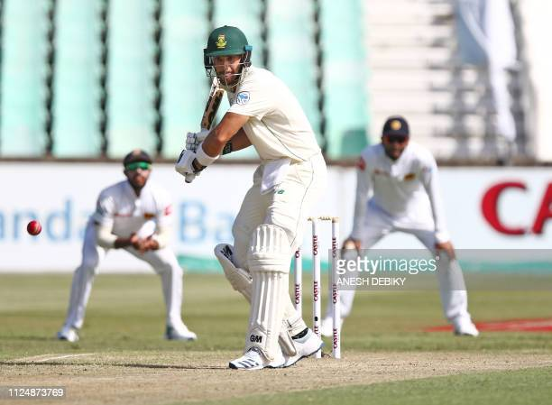South Africa's Aiden Markram eyes the ball on day 2 of the first test match between South Africa and Sri Lanka held at the Kingsmead Stadium in...
