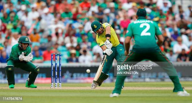 South Africa's Aiden Markram is watched by Bangladesh's wicketkeeper Mushfiqur Rahim and Bangladesh's captain Mashrafe Mortaza as he plays a shot...