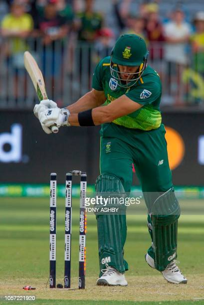 South Africa's Aiden Markram reacts by knocking the bails off after being dismissed during the first oneday international cricket match between South...