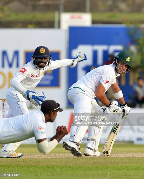 South Africa's Aiden Markram watches as Sri Lankan cricketer Angelo Mathews takes a catch to dismiss him during the first day of the opening Test...