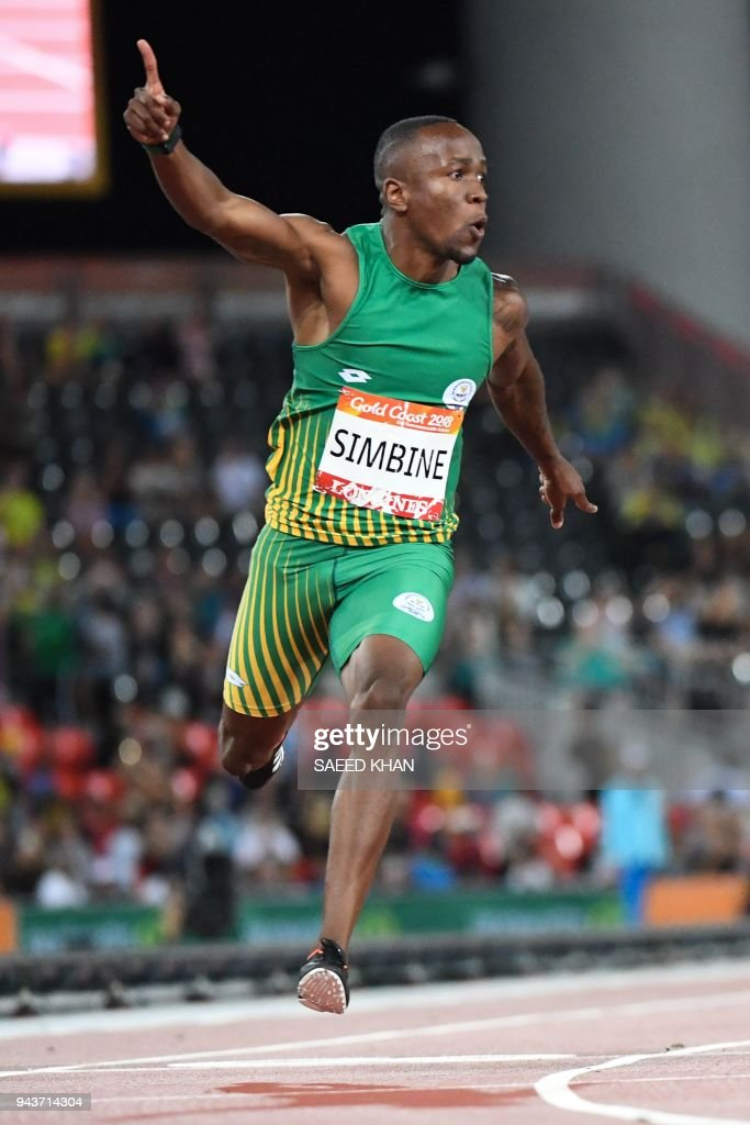 South Africas Akani Simbine (gold) wins the athletics men's 100m final during the 2018 Gold Coast Commonwealth Games at the Carrara Stadium on the Gold Coast on April 9, 2018. /