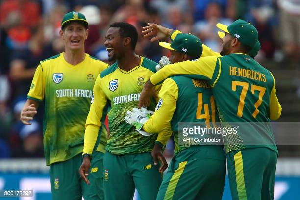 South Africa's Andile Phehlukwayo celebrates with teammates after sealing victory with the final ball of the second international Twenty20 cricket...