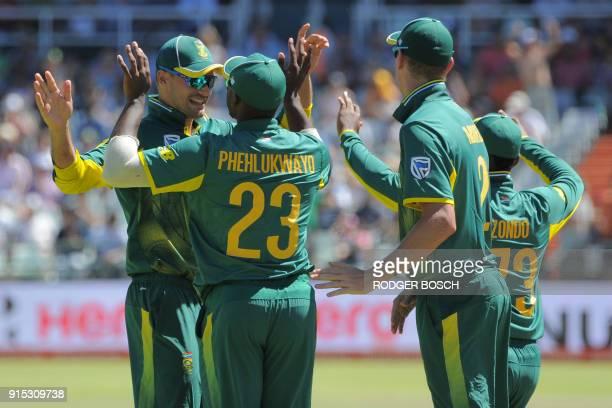 South Africa's Andile PHehlukwayo celebrates with teammates after catching India's Ajinkya Rahane during the One Day International cricket match...