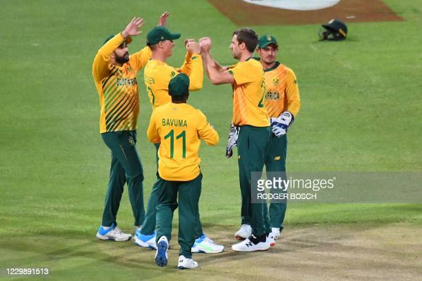 South Africa's Anrich Nortje celebrates with teammates after the dismissal of England's Jason Roy during the third T20 international cricket match...