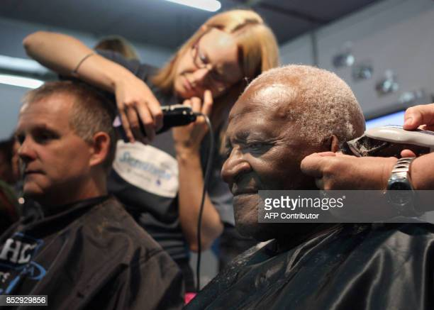 South Africa's Archbishop and Nobel Peace Prize Laureate Desmond Tutu has his head shaved on March 07 2008 Tutu agreed to have his head shaved as...