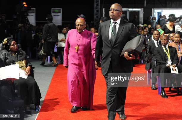 South Africa's archbishop emeritus Desmond Tutu arrives for the funeral ceremony of South African former president Nelson Mandela in Qunu on December...