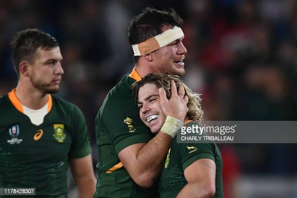 TOPSHOT South Africa's back row Francois Louw hugs South Africa's scrumhalf Faf de Klerk after winning the Japan 2019 Rugby World Cup semifinal match...