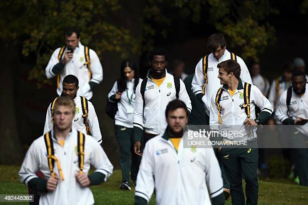 South Africa's back row Siya Kolisi arrives for a team training session at the Pennyhill park hotel in Bagshot on October 13 2015 during the 2015...