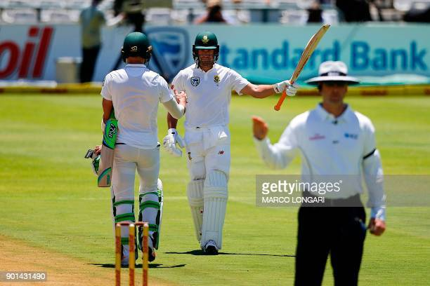 South Africa's batsman AB de Villiers celebrates scoring a HalfCentury during day one of the First Test between South Africa and India in Cape Town...