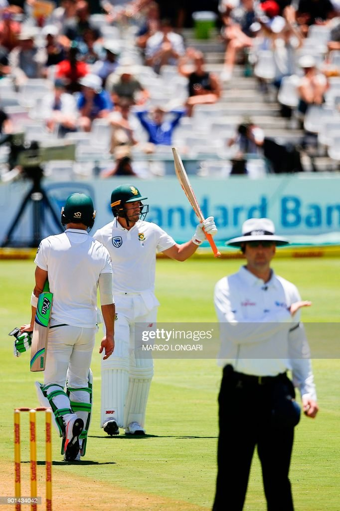 South Africa's batsman AB de Villiers (C) celebrates scoring a Half-Century during day one of the First Test between South Africa and India in Cape Town, on January 5, 2018. /