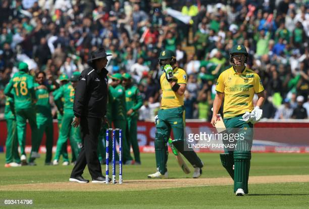 South Africa's batsman AB de Villiers leaves the crease after being caught by Pakistan fielder Mohammad Hafeez bowled by Imad Wasim on no runs during...