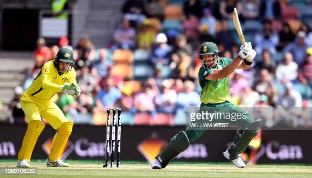 South Africa's batsman Aiden Markram cuts a ball away as Australian wicketkeeper Alex Carey looks on during the third oneday international cricket...