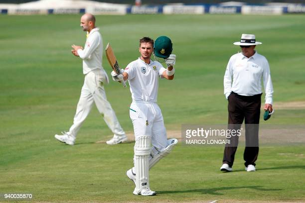 South Africa's batsman Aiden Markram raises his bat to celebrate scoring a century during day one of the fourth Sunfoil cricket test match between...