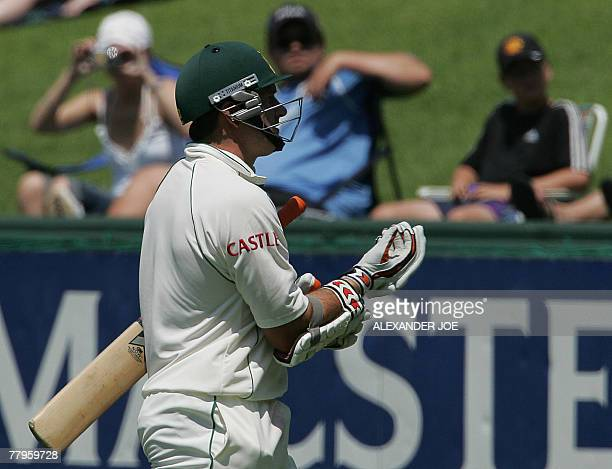 South Africa's batsman Captain Graeme Smith walks off after he was clean bowled for 2 runs by New Zealand's last bowler Chris Martin 17 November 2007...