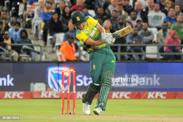 South Africa's batsman Chris Morris is bowled out by India's bowler Jasprit Bumrah during the third T20 cricket match between India and South Africa...