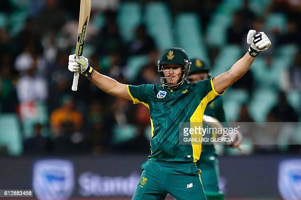 South Africa's batsman David Miller celebrates scoring a century during the third One Day International between South Africa and Australia at...