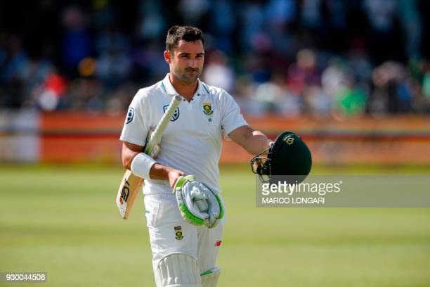 South Africa's batsman Dean Elgar leaves the ground after having been dismissed by Australia bowler Josh Hazlewood during day two of the second...