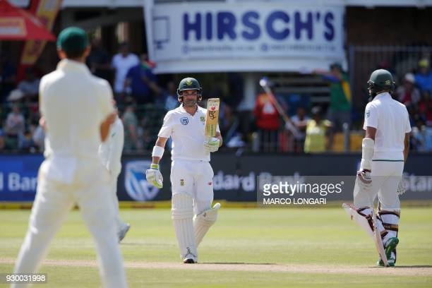 South Africa's batsman Dean Elgar raises his bat to celebrate scoring a halfcentury during day two of the second Sunfoil Cricket Test match between...