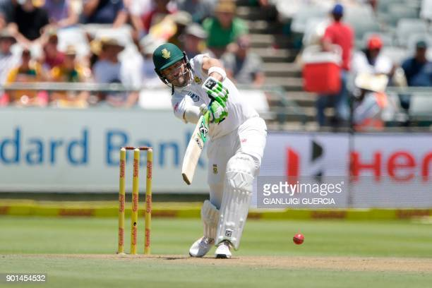 South Africa's batsman Faf du Plessis plays a shot during the first day of the first Test cricket match between South Africa and India at Newlands...