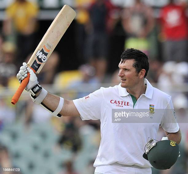 South Africa's batsman Graeme Smith celebrates his 100 runs against Australia on the second day of the second cricket Test match at the Adelaide Oval...