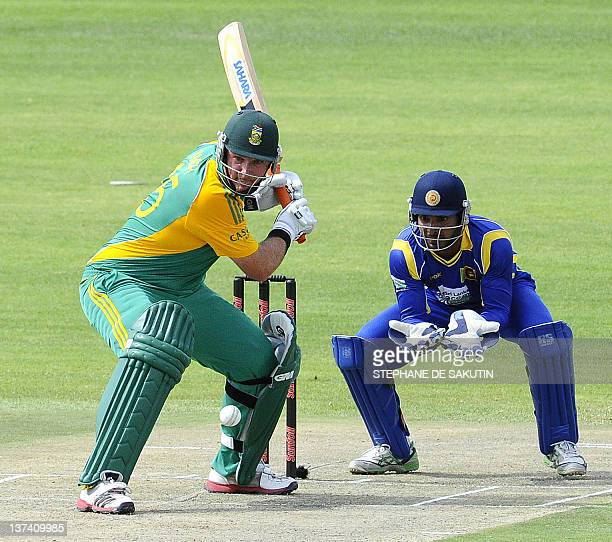 South Africa's batsman Graeme Smith plays a shot as Sri Lanka's wicketkeeper Kumar Sangakkara waits to make a catch during the fourth One Day...