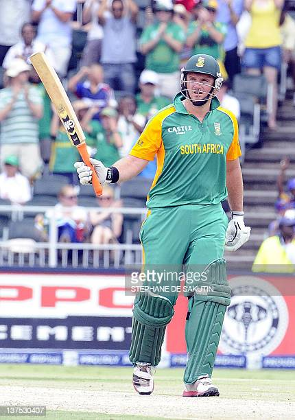 South Africa's batsman Graeme Smith raises his bat to celebrate his halfcentury during the fifth One Day International match between South Africa and...