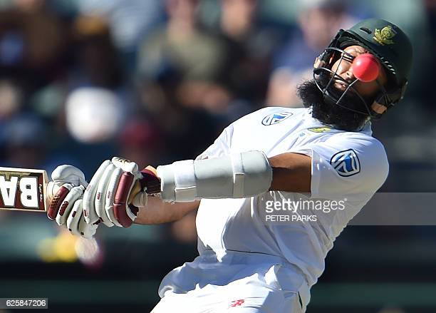 South Africa's batsman Hashim Amla avoids a bouncer during the third day of the third Test cricket match between Australia and South Africa at the...