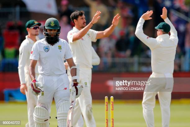 South Africa's batsman Hashim Amla leaves the ground after having been dismissed by Australia bowler Mitchell Starc during day two of the second...