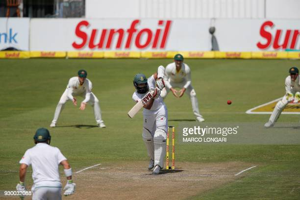 South Africa's batsman Hashim Amla plays a shot during day two of the second Sunfoil Cricket Test match between South Africa and Australia at St...