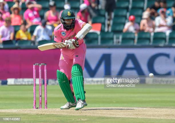 South Africa's batsman Hashim Amla plays a shot during the 4th ODI cricket match between South Africa and Pakistan at the Wanderers cricket stadium...