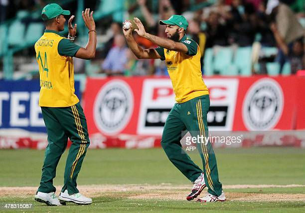 South Africa's Beuran Hendricks and Hashim Amla celebrate Aaron Finch's wicket during the Second KFC T20 International match between South Africa and...