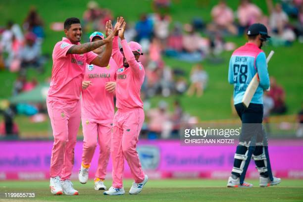 South Africa's Beuran Hendricks celebrates with teammates after the dismissal of England's Tom Banton during the third one day international cricket...