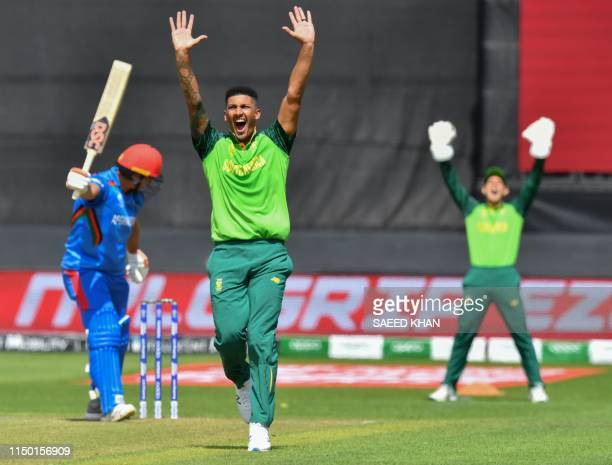 South Africa's Beuran Hendricks makes an appeal for a leg before wicket decision against Afghanistan's Hazratullah Zazai during the 2019 Cricket...