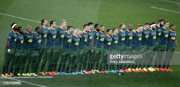 South Africa's blindside flanker and aptain Siya Kolisi leads his players as they sing the national anthem ahead of the first rugby union Test match...